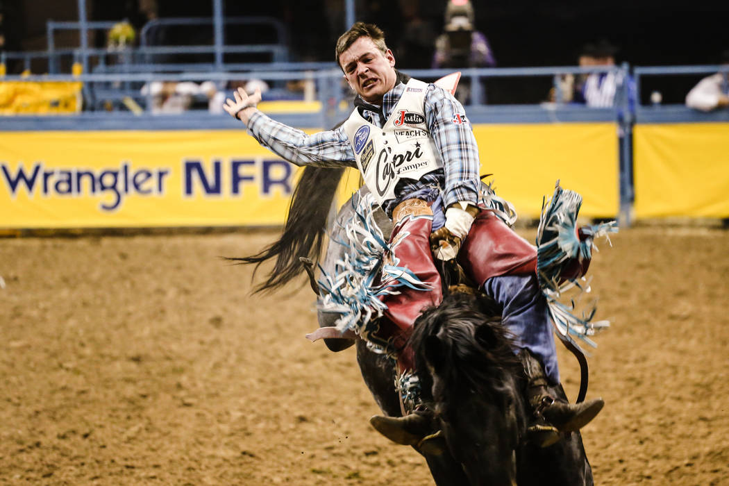 Tim O'Connell of Zwingle, Iowa rides Fire Water in the bareback riding event during the fourth night of the 59th Wrangler National Finals Rodeo at the Thomas & Mack Center in Las Vegas, Sunday ...