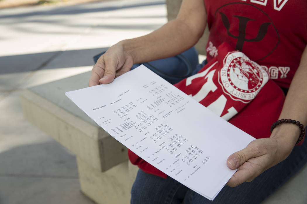 Ellen Fumo, 52, a student at UNLV with a bachelor's degree in psychology, shows her school transcript dating back to 1983, at UNLV in Las Vegas, Wednesday, Dec. 13, 2017. Erik  ...