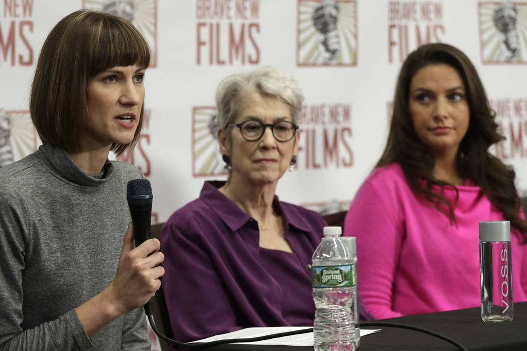 Rachel Crooks, left, Jessica Leeds, center, and Samantha Holvey attend a news conference, Monday, Dec. 11, 2017, in New York to discuss their accusations of sexual misconduct against Donald Trump. ...
