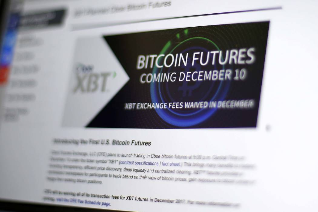 This Friday, Dec. 8, 2017, photo shows the Chicago Board Options Exchange website announcing that bitcoin futures will start trading on the CBOE on Sunday evening, Dec. 10. Bitcoin futures will st ...