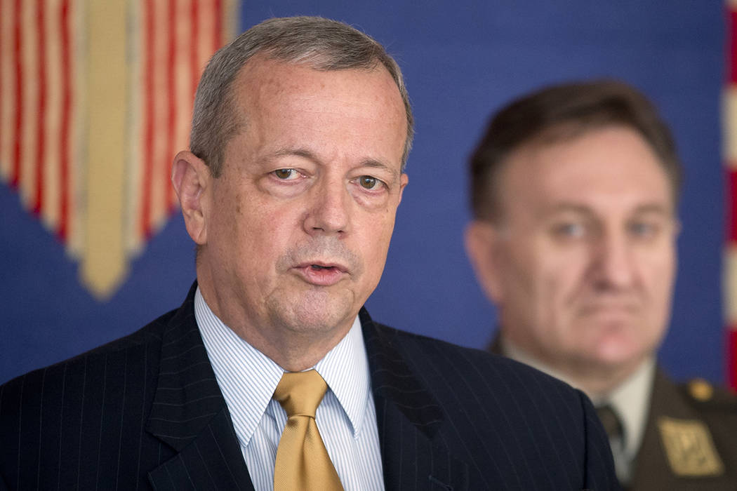 US Ret. Gen. John Allen left, addresses the media at the presidential palace during a break of his meetings, in Zagreb, Croatia, Tuesday, June 9, 2015.  (AP Photo/Darko Bandic)