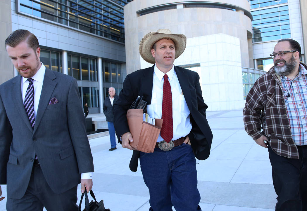 Ammon Bundy, center, leaves the Lloyd George U.S. Courthouse on Monday, Dec. 11, 2017, in Las Vegas. A federal judge in Las Vegas raised the prospect of a mistrial Monday for four main defendants, ...
