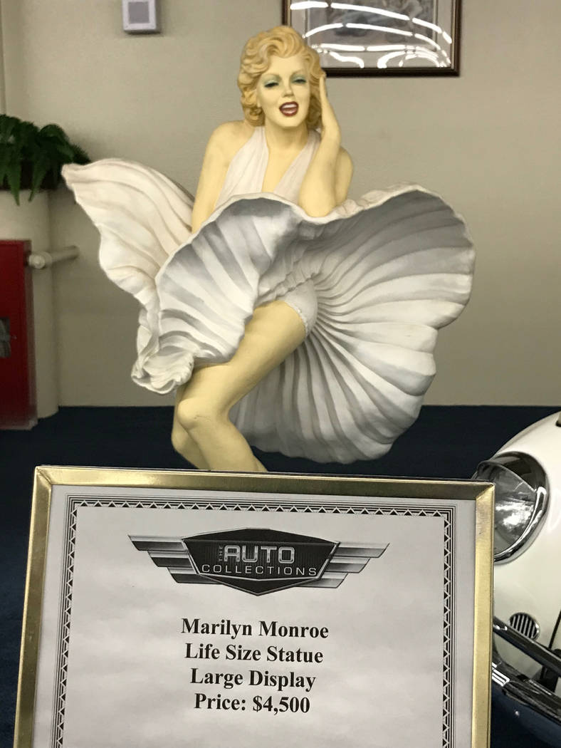A Marilyn Monroe life-size statue on display at The Auto Collections vintage-car museum and store at The Linq hotel-casino in Las Vegas, Tuesday, Dec. 12, 2017. The vintage dealer is closing to th ...