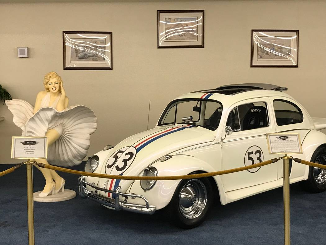 A Marilyn Monroe life-size statue and 1963 Volkswagen Beetle on display at The Auto Collections vintage-car museum and store at The Linq hotel-casino in Las Vegas, Tuesday, Dec. 12, 2017. The vint ...