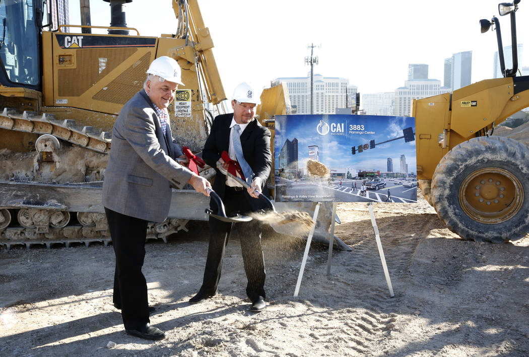 Clark County Commissioner Steve Sisolak, left, and developer Chris Beavor hold a ceremonial groundbreaking for a mixed-use project at 3883 Flamingo Road next to the Palms, Friday, Dec. 15, 2017, i ...