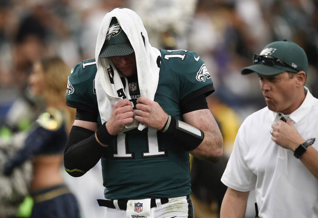 Philadelphia Eagles quarterback Carson Wentz leaves the field during the second half of an NFL football game against the Los Angeles Rams Sunday, Dec. 10, 2017, in Los Angeles.(AP Photo/Kelvin Kuo)