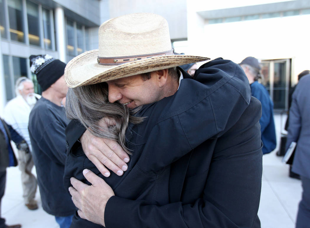 Defendant Ammon Bundy hugs supporter Terry Noonkester outside the Lloyd George U.S. Courthouse on Wednesday, Dec. 20, 2017, after a mistrial was declared in the Bunkerville standoff case. K.M. Can ...