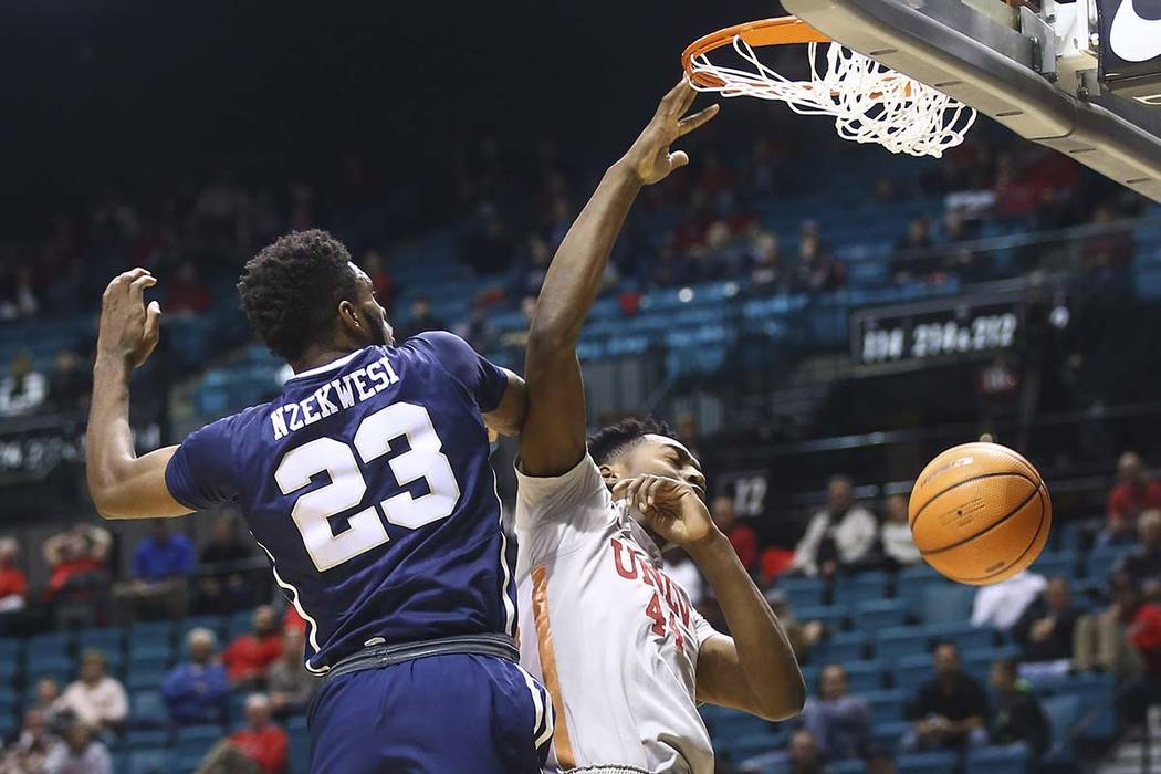 UNLV's Brandon McCoy (44) dunks against Oral Roberts' Emmanuel Nzekwesi (23) during their basketball game at the MGM Grand Garden Arena in Las Vegas on Tuesday, Dec. 5, 2017. UNLV won 92-66. Chase ...