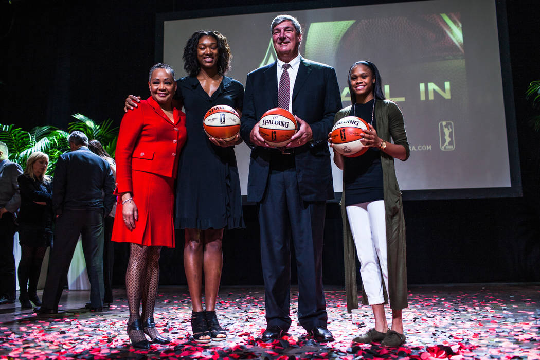WNBA President Lisa Borders, left, Las Vegas Aces' Kayla Janine Alexander, second from left, Las Vegas Aces head coach Bill Laimbeer, second from right, Las Vegas Aces' Moriah Jefferson, right, ga ...