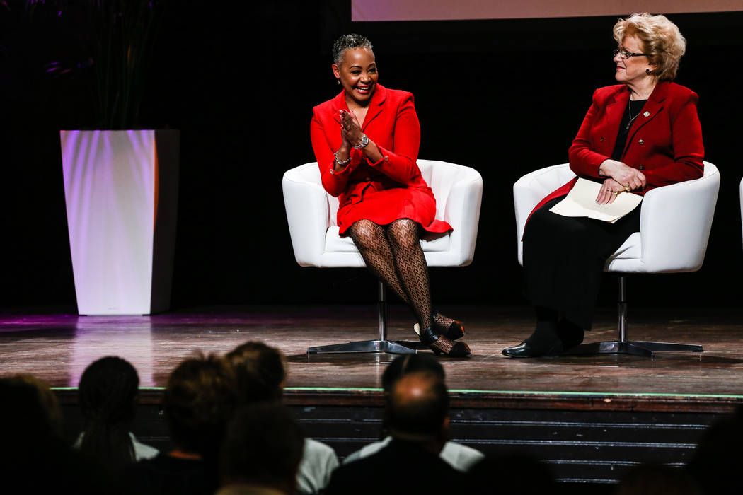 WNBA President Lisa Borders, left, claps as she sits next to Las Vegas Mayor Carolyn Goldmark Goodman, right, during the reveal of the Las Vegas Aces WNBA basketball team at the House of Blues at  ...