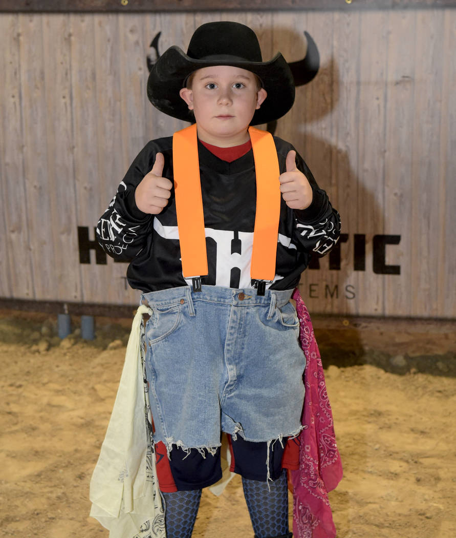 Kiley Timberman takes on the responsibilities of the bull fighter as special needs children experience the world of rodeo with Wrangler NFR contestants, announcers, personnel and even Miss Rodeo A ...