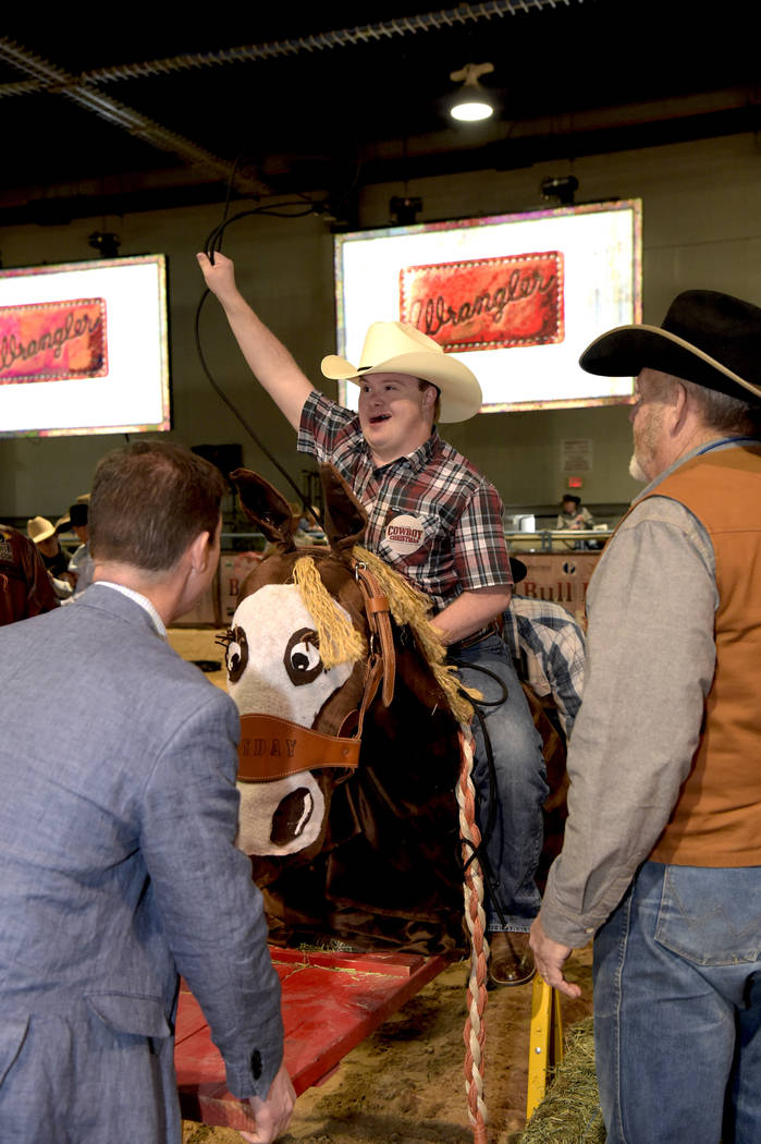 Dave Nielson makes his 8 seconds on his saddle bronc ride as special needs children experience the world of rodeo with Wrangler NFR contestants, announcers, personnel and even Miss Rodeo America a ...