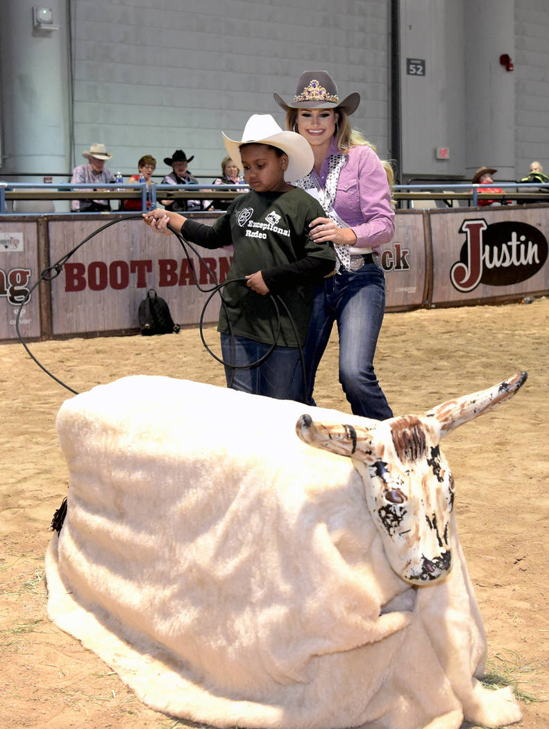 The current Miss Rodeo America Lisa Lageschaar helps with steer roping as special needs children experience the world of rodeo with Wrangler NFR contestants, announcers, personnel and even Miss Ro ...