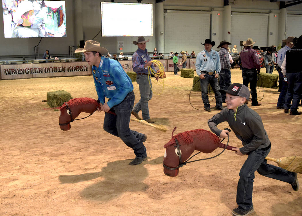 Champion Steer Wrestler Tyler Waguespack takes on challengers as special needs children experience the world of rodeo with Wrangler NFR contestants, announcers, personnel and even Miss Rodeo Ameri ...