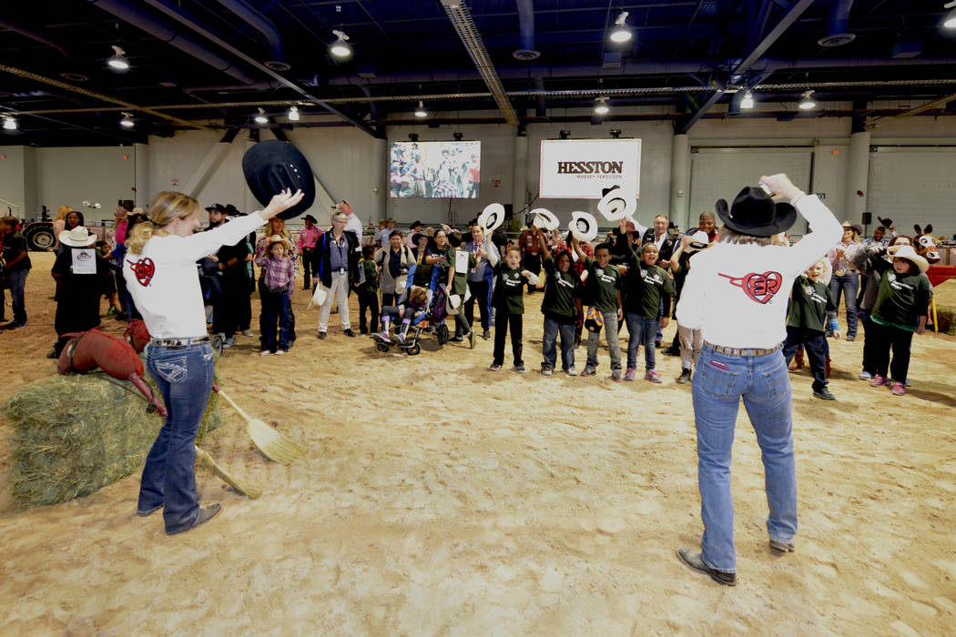 Contestants tip their hats to the audience as special needs children experience the world of rodeo with Wrangler NFR contestants, announcers, personnel and even Miss Rodeo America at The Exception ...