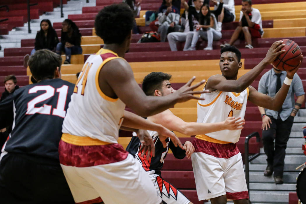 Del Sol's Tyrell Hampton (0) is guarded by Southeast Career Tech's Isaiah Villarreal (24) during the first quarter of a basketball game at Del Sol High School in Las Vegas, Thursday, Dec. 14, 2017 ...