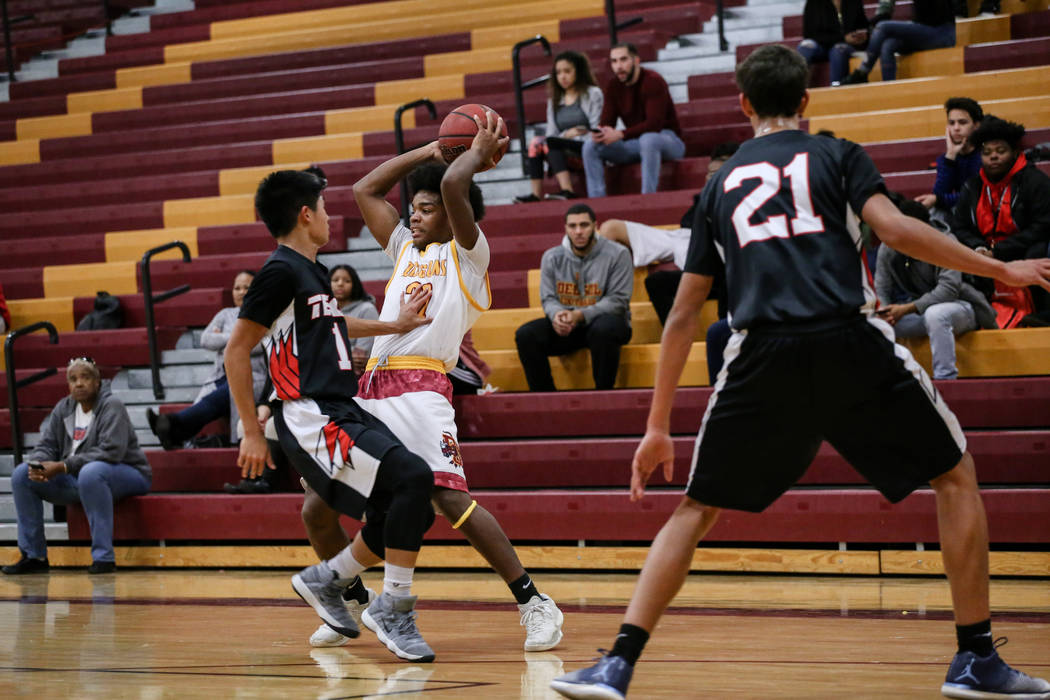 Southeast Career Tech's Jurelle Orbino (1) guards Del Sol's Keith Seldon (22) during the second quarter of a basketball game at Del Sol High School in Las Vegas, Thursday, Dec. 14, 2017. Del Sol w ...