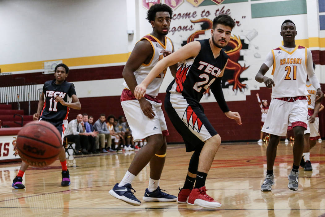 Del Sol's Nati Asfaw (24), left, and Southeast Career Tech's Isaiah Villarreal (24) eye the ball during the third quarter of a basketball game at Del Sol High School in Las Vegas, Thursday, Dec. 1 ...