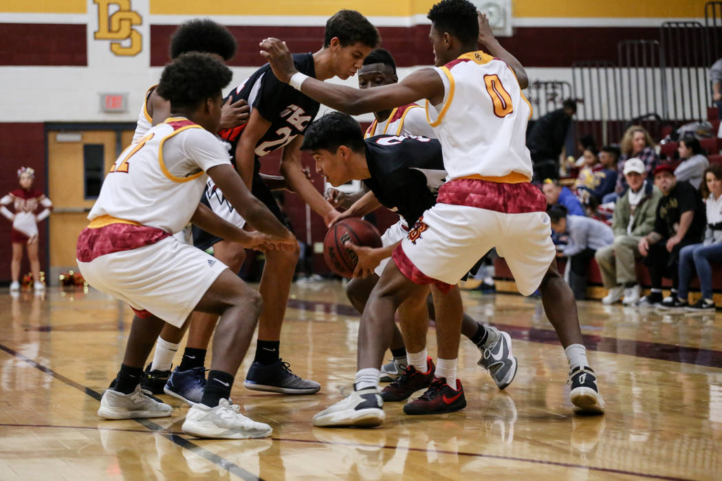 Southeast Career Tech's Miguel Pena (3) is surrounded by Del Sol defenders during the third quarter of a basketball game at Del Sol High School in Las Vegas, Thursday, Dec. 14, 2017. Del Sol won 6 ...