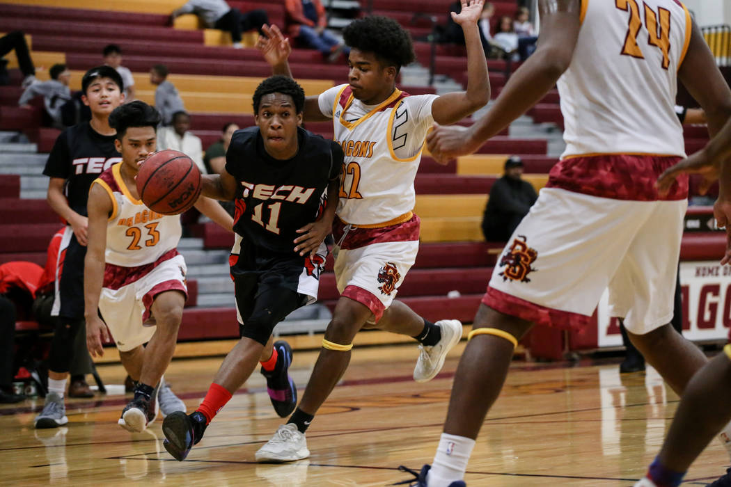 Southeast Career Tech's Zail Lewis (11) dribbles the ball as he is guarded by Del Sol's Keith Seldon (22) during the third quarter of a basketball game at Del Sol High School in Las Vegas, Thursda ...