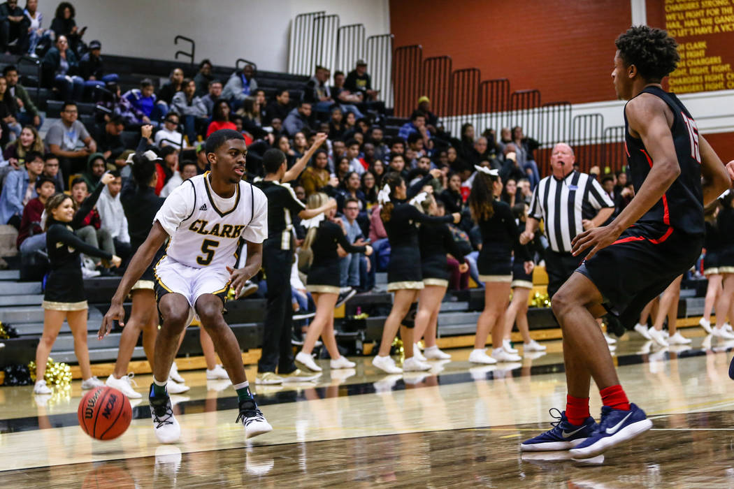 Clark Chargers' James Bridges (15) dribbles the ball during the second quarter of a basketball game against Liberty at Ed W. Clark High School in Las Vegas, Friday, Dec. 15, 2017. Clark Chargers w ...