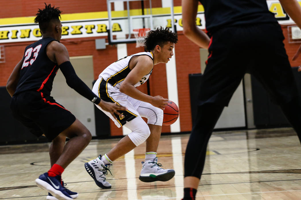Liberty's Davion Ware (23) guards Clark Chargers' Jalen Hill (21) during the second quarter of a basketball game at Ed W. Clark High School in Las Vegas, Friday, Dec. 15, 2017. Clark Chargers won  ...