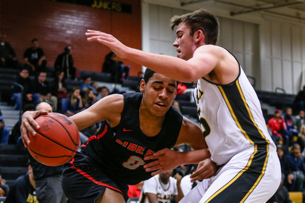 Liberyճ Julian Strawther (0) is guarded by Clark ChargersՠJames Bridges (15) during the first quarter of a basketball game at Ed W. Clark High School in Las Vegas, Friday, Dec. 15, 201 ...