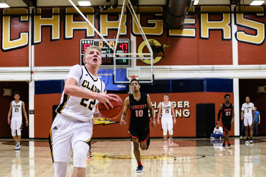 Clark ChargersՠTrey Woodbury (22) runs before scoring a slam dunk against Liberty during the fourth quarter of a basketball game at Ed W. Clark High School in Las Vegas, Friday, Dec. 15, 201 ...