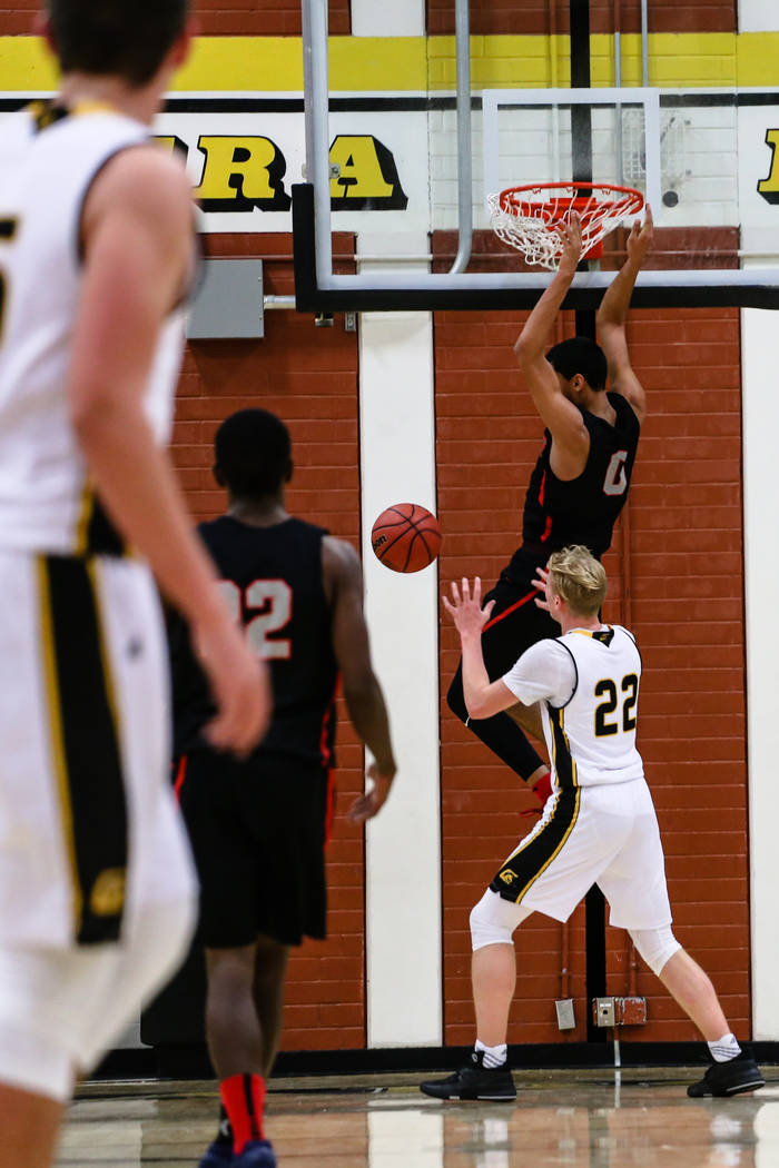 Liberyճ Julian Strawther (0) scores against Clark ChargersՠTrey Woodbury (22) during the second quarter of a basketball game at Ed W. Clark High School in Las Vegas, Friday, Dec. 15, 2 ...