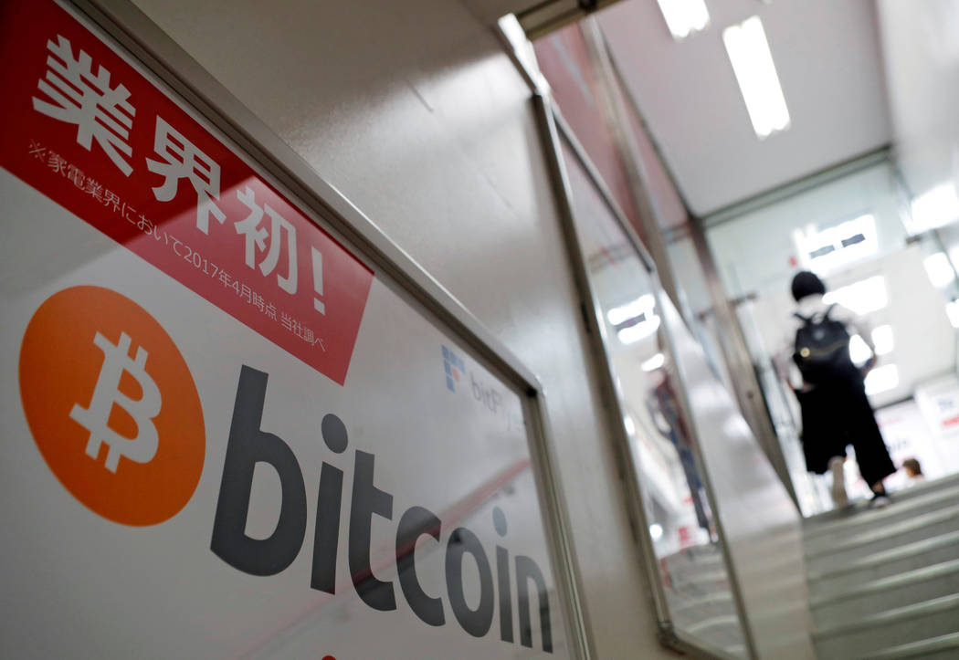 A logo of Bitcoin is seen on an advertisement of an electronic shop in Tokyo, Japan September 5, 2017. (Kim Kyung-Hoon/Reuters, File)