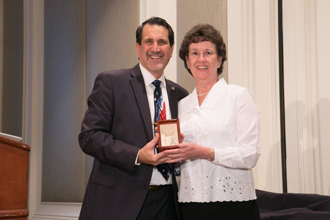 The Southern Nevada Home Builders Association SNHBA Executive Director Nat Hodgson presented a gold watch to Public Affairs Director Monica Caruso for 37 years of service to the association. Hodgs ...