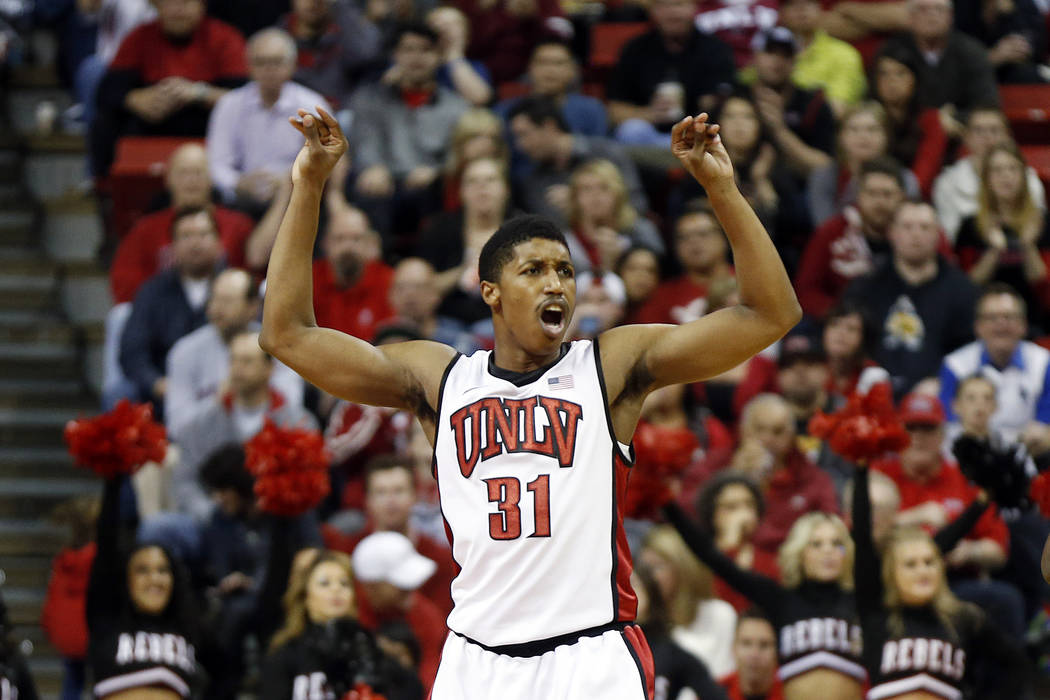 UNLV's Justin Hawkins celebrates a score during the second half of an NCAA college basketball game against Colorado State on Wednesday, Feb. 20, 2013, in Las Vegas. UNLV defeated Colorado State 61 ...