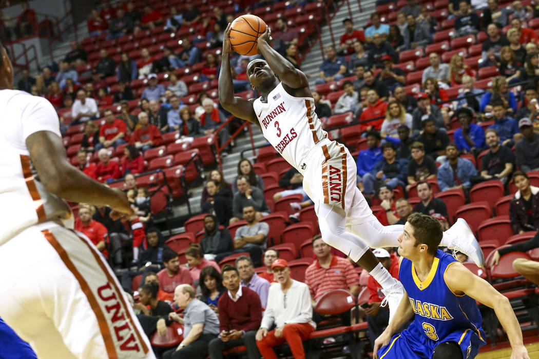 UNLV Rebels guard Amauri Hardy (3) takes a shot as he is  fouled by Alaska Nanooks guard Jason McCullough (3) during an exhibition basketball game at the Thomas & Mack, Friday, Nov. 3, 2017. U ...