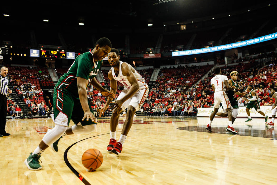 Mississippi Valley State Delta Devils forward Davere Creighton (20) is guarded by UNLV Rebels forward Shakur Juiston (10) during the first half of a basketball game at the Thomas & Mack Center ...