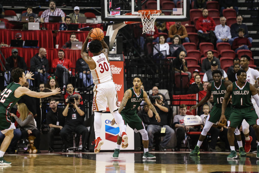 UNLV Rebels guard Jovan Mooring (30) scores against the Mississippi Valley State Delta Devils during the first half of a basketball game at the Thomas & Mack Center in Las Vegas, Wednesday, De ...