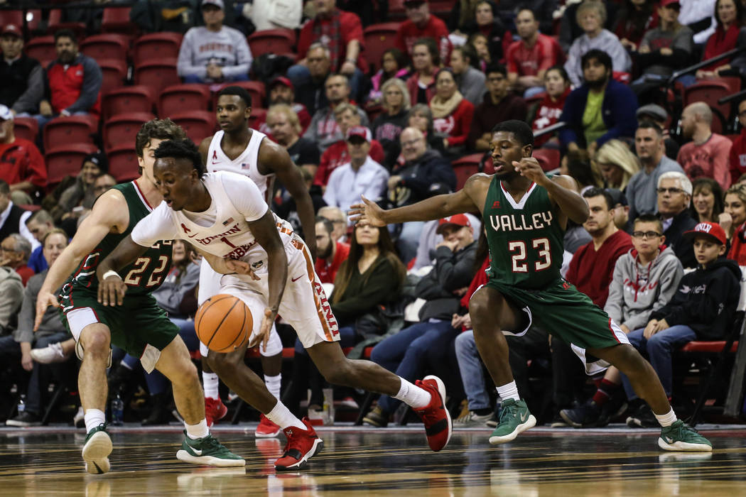 Mississippi Valley State Delta Devils guard Nate Nahimy (22) guards UNLV Rebels guard Kris Clyburn (1) during the first half of a basketball game at the Thomas & Mack Center in Las Vegas, Wedn ...