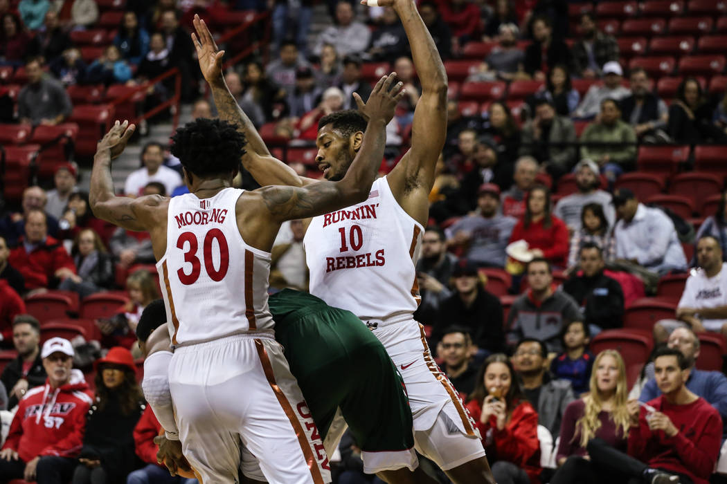 UNLV Rebels guard Jovan Mooring (30) and UNLV Rebels forward Shakur Juiston (10) guard Mississippi Valley State Delta Devils forward Dante Scott (1) during the first half of a basketball game at t ...