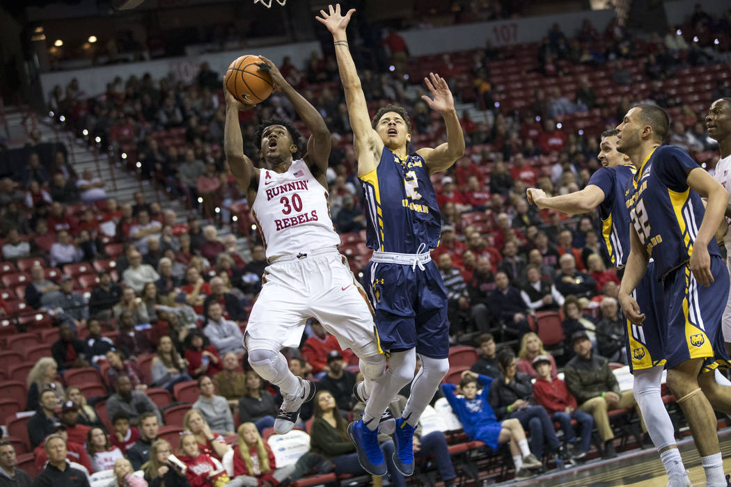 UNLV Rebels guard Jovan Mooring (30) shoots over Northern Colorado Bears guard Jonah Radebaugh (12) during the first period of an NCAA college basketball game at the Thomas & Mack Center, Frid ...