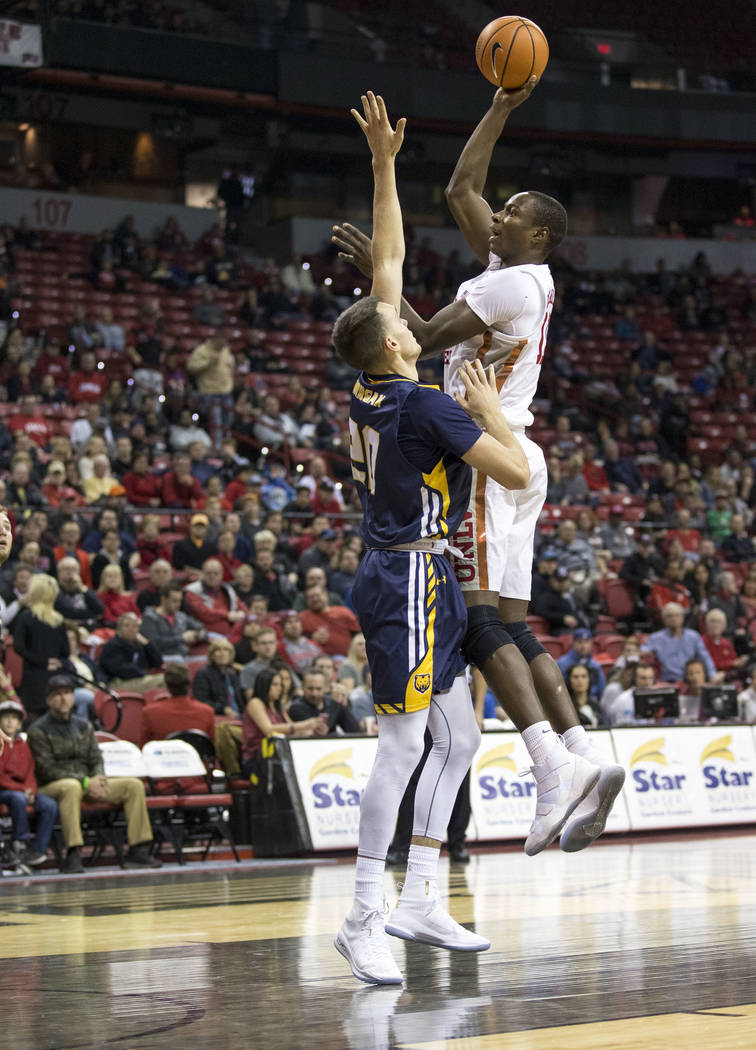 UNLV Rebels forward Cheickna Dembele (11) shoots over Northern Colorado Bears forward Tanner Morgan (20) during the first period of an NCAA college basketball game at the Thomas & Mack Center, ...