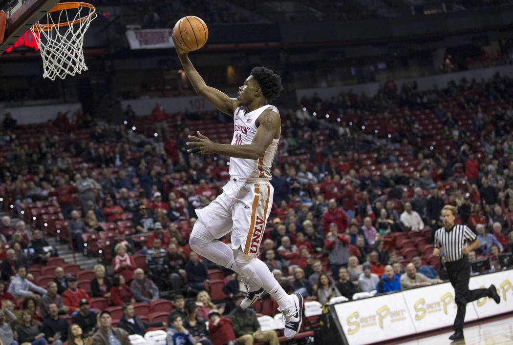 UNLV Rebels guard Jovan Mooring (30) breaks away for a point against the Northern Colorado Bears during the first period of an NCAA college basketball game at the Thomas & Mack Center, Friday, ...