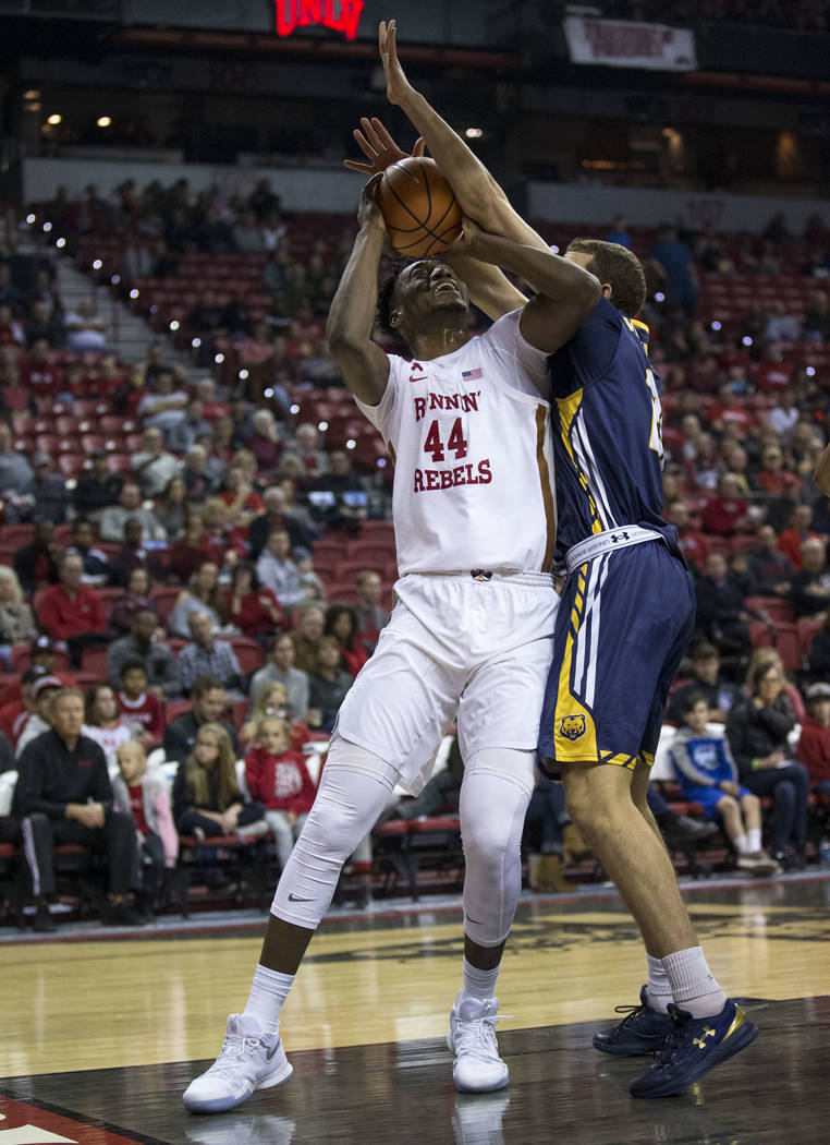 UNLV Rebels forward Brandon McCoy (44) gets block by Northern Colorado Bears forward Roberto Vercellino (21) during the first period of an NCAA college basketball game at the Thomas & Mack Cen ...