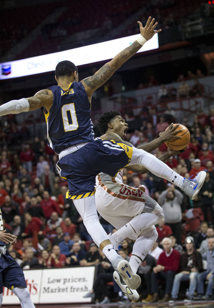 UNLV Rebels guard Jovan Mooring (30) goes up for a shot before Northern Colorado Bears guard Jordan Davis (0) during the second period of an NCAA college basketball game at the Thomas & Mack C ...