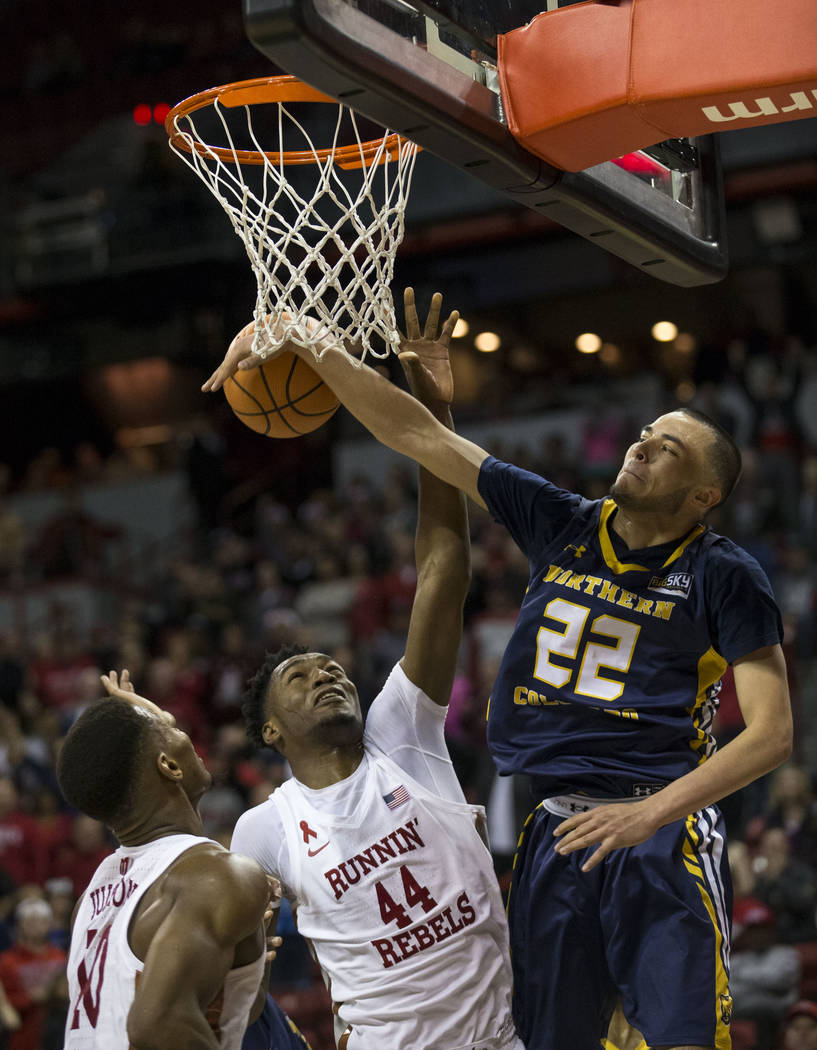 UNLV Rebels forward Brandon McCoy (44) and Northern Colorado Bears guard Jalen Sanders (22) vie for the rebound during the second period of an NCAA college basketball game at the Thomas & Mack ...