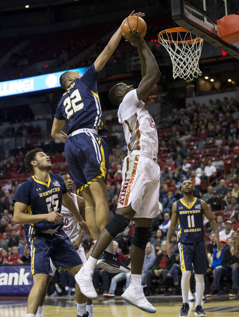 UNLV Rebels forward Cheickna Dembele (11) is blocked by Northern Colorado Bears guard Jalen Sanders (22) during the second period of an NCAA college basketball game at the Thomas & Mack Center ...