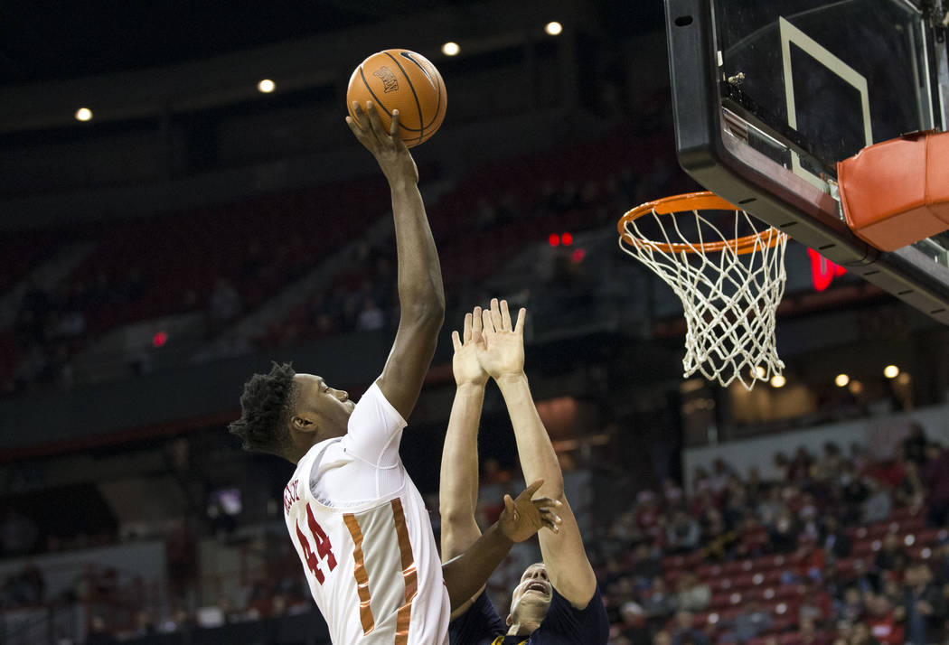 UNLV Rebels forward Brandon McCoy (44) takes a shot over Northern Colorado Bears forward Ibrahim Sylla (10) during the second period of an NCAA college basketball game at the Thomas & Mack Cen ...
