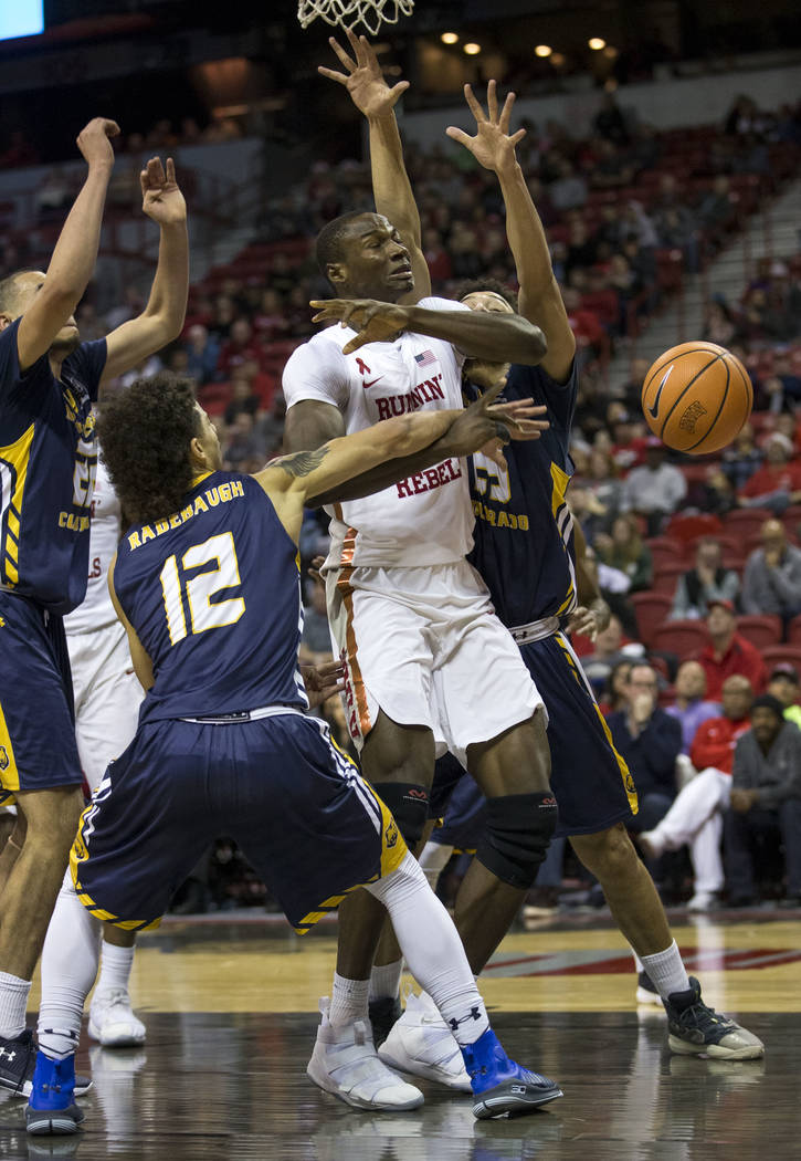Northern Colorado Bears guard Jonah Radebaugh (12) knocks the ball away from UNLV Rebels forward Cheickna Dembele, center, during the second period of an NCAA college basketball game at the Thomas ...