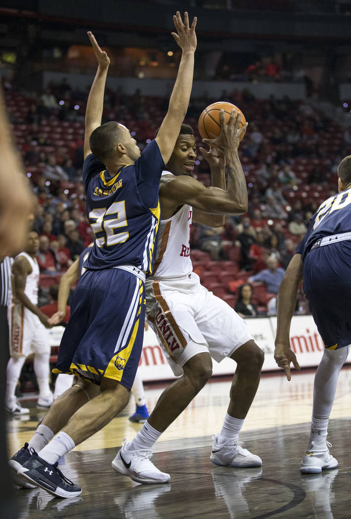 Northern Colorado Bears guard Jalen Sanders (22) puts pressure on UNLV Rebels forward Shakur Juiston (10) during the first period of an NCAA college basketball game at the Thomas & Mack Center ...