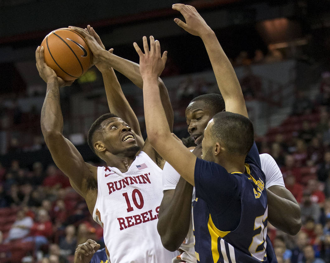 UNLV Rebels forward Shakur Juiston (10) looks for a shot through Northern Colorado Bears defenders during the second period of an NCAA college basketball game at the Thomas & Mack Center Frida ...