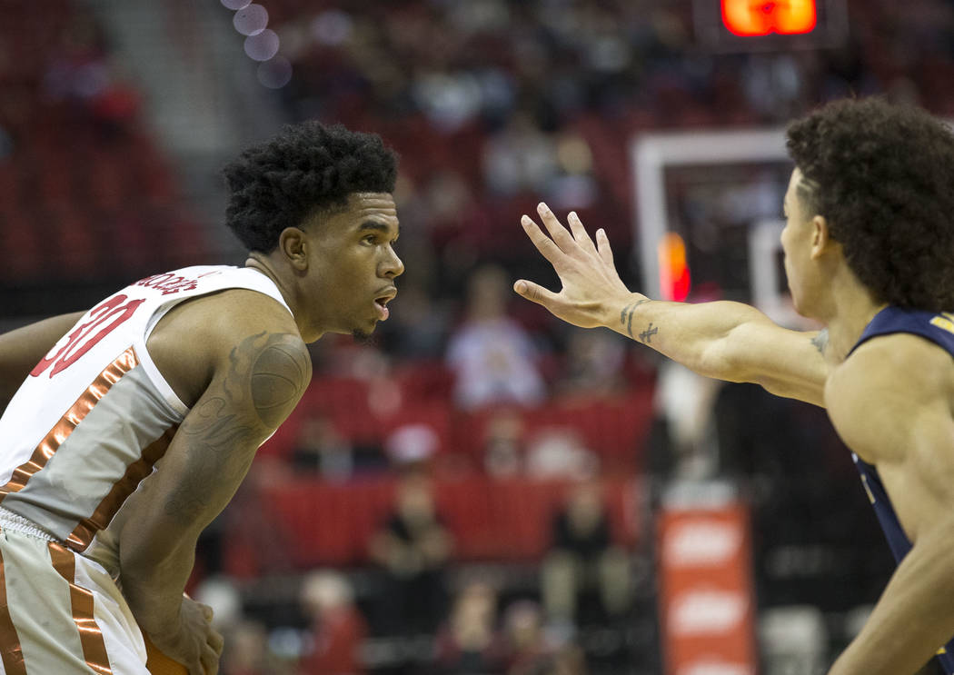 UNLV Rebels guard Jovan Mooring (30) is pressured by Northern Colorado Bears guard Jonah Radebaugh (12) during the second period of an NCAA college basketball game at the Thomas & Mack Center  ...