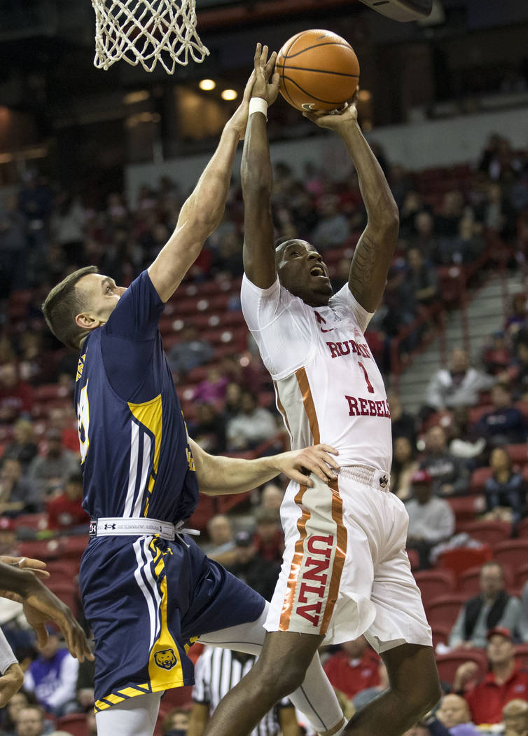 UNLV Rebels guard Kris Clyburn (1) gets blocks by Northern Colorado Bears forward Tanner Morgan (20) during the second period of an NCAA college basketball game at the Thomas & Mack Center Fri ...